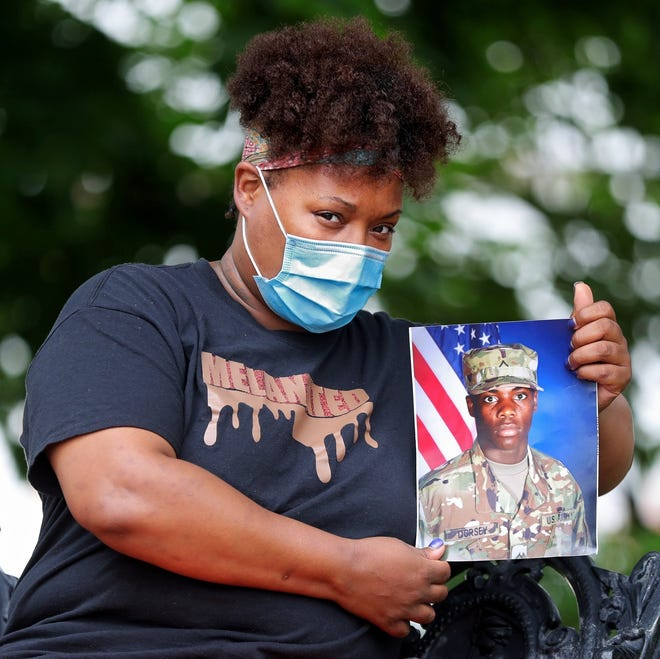 Tymica Dorsey holds up a portrait of her son Jozaih, who was quarantined at Fort Campbell with coronavirus, Thursday, July 23, 2020, in Akron, Ohio.
