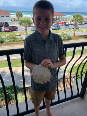 Syler Elliott, 11, of Hanover, dove in the Gulf of Mexico and found an estimated 6-inch sand dollar while on vacation in Destin, Florida.