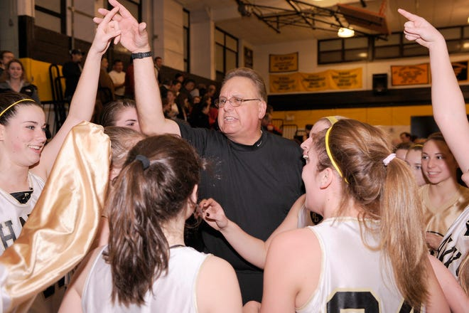 River Dell's girls baskeball team celebrates with head coach Lou Wejnert after the Hawks' sectional championship in 2010.