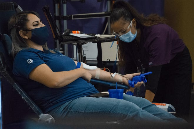 Lizett Lopez, front desk receptionist for Las Cruces City Hall, prepares to donate blood at a blood drive hosted by the city on Monday, July 27, 2020.