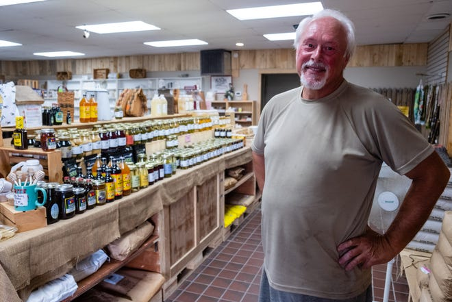 Randall Hund, who owns Amish Country Bulk Store in Fort Gratiot, poses for a photo inside the store Monday, July 27, 2020. The store is moving from its current location to a storefront at 3927 Pine Grove Ave. in Fort Gratiot.