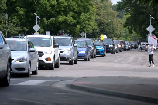 Cars with demonstrators inside line Court St NE during a car caravan to protest for students and educators safety as schools re-open, at the Capitol in Salem, Oregon, on Monday, July 27, 2020.