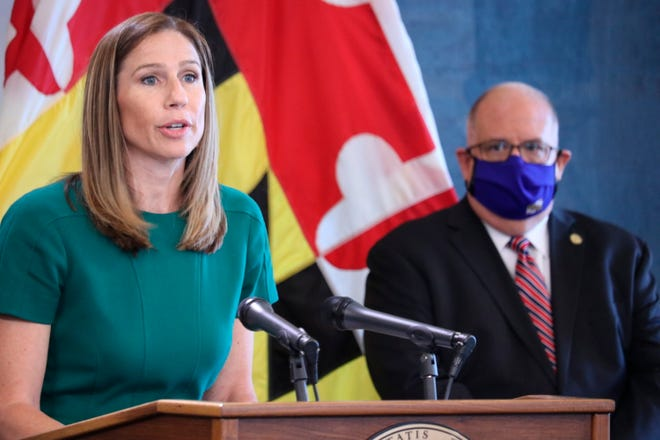 Maryland Labor Department Secretary Tiffany Robinson talks about the state's uncovering of more than 47,500 fraudulent unemployment insurance claims totaling more than $501 million at a news conference in Annapolis, Md., on Wednesday, July, 15, 2020. Gov. Larry Hogan is standing right.