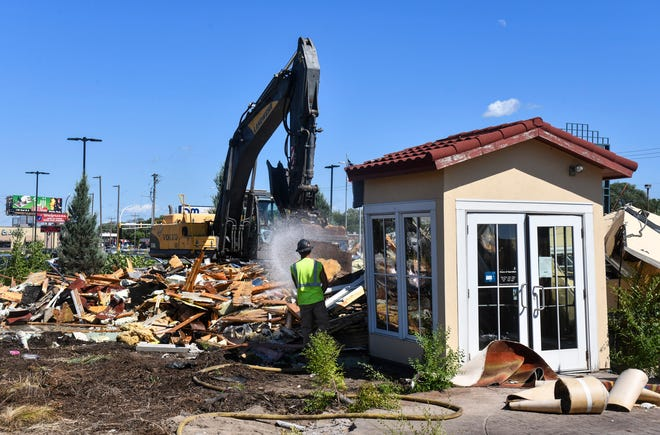 The front entryway is about all that remains standing as crews demolish the former Ciatti's Ristorante location at 2635 Division St. W Monday, July 27, 2020, in St. Cloud. Ciatti's closed in 2018 after more than 30 years of operation in St. Cloud.