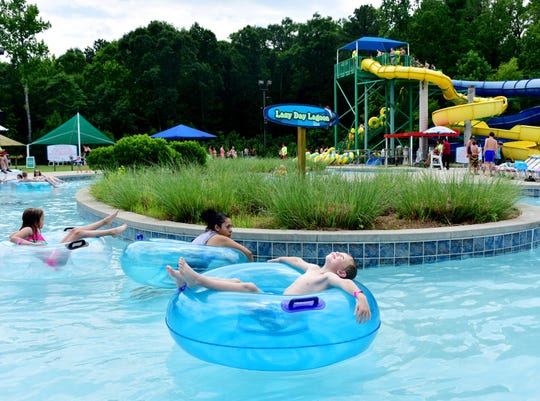 Children wade in the Lazy Day Lagoon at Discovery Island at Southside Park in Simpsonville.