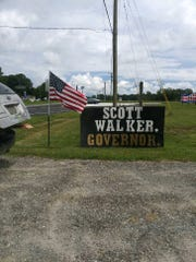 Failed 2018 congressional candidate Scott Walker, now a Republican, has erected hand-made signs across the state for his 2020 gubernatorial campaign.