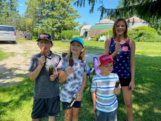 Grandma supplied the ice cream bars to Eli, Arianna, Wyatt and Serenity. The beginning everyone was neat and tidy.