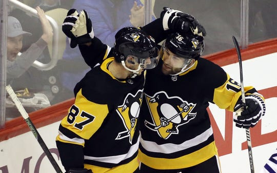 Penguins center Sidney Crosby (87) congratulates left wing Jason Zucker (16) on his goal against the Maple Leafs in February.