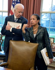 Vice President Joe Biden and National Security Adviser Susan Rice talk as President Barack Obama and Iraqi Prime Minister Haider al-Abadi brief the press after a bilateral meeting in the Oval Office of the White House on April 14, 2015.