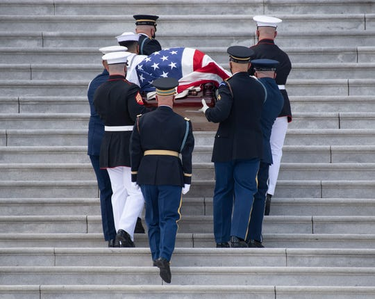 The casket of Rep. John Lewis carried by military honor guard up the steps of the U.S. Capitol on July 27, 2020 in Washington.
