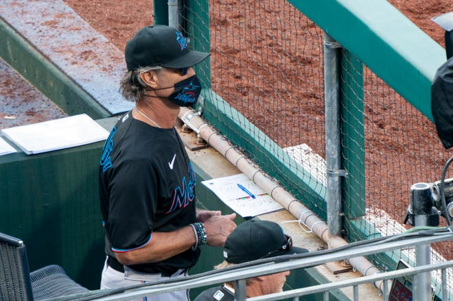 Miami Marlins manager Don Mattingly looks out from the dugout during the eighth inning against the Philadelphia Phillies.