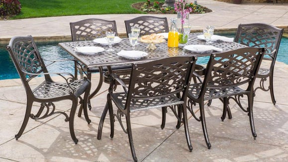 Enjoy outdoor dining with a durable set of table and chairs.