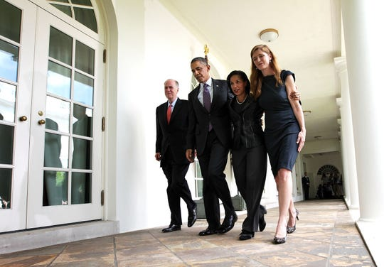 President Barack Obama, second from left, former aide Samantha Power, right, U.S. Ambassador to the United Nations Susan Rice, third from left, and incumbent National Security Adviser Tom Donilon return to the Oval Office after a announcement at the Rose Garden of the White House on June 5, 2013