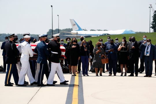 The flag-draped casket of Rep. John Lewis, D-Ga., is carried by a joint services military honor guard to the hearse, Monday, July 27, 2020, at Andrews Air Force Base, Md.