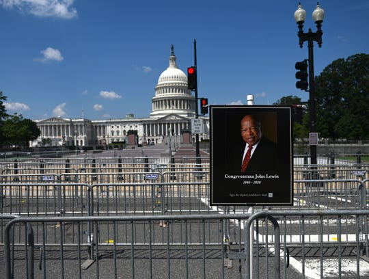 Security barriers are seen setup for the public viewing later in the day of former Congressman John Lewis (D-GA) in Washington, DC on July 27, 2020.