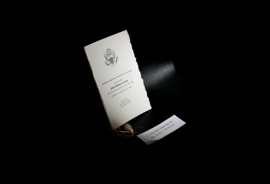 A program is seen on a seat inside of the Capitol Rotunda prior to a service honoring the late Rep. John Lewis, D-Ga., Monday, July 27, 2020 in Washington.