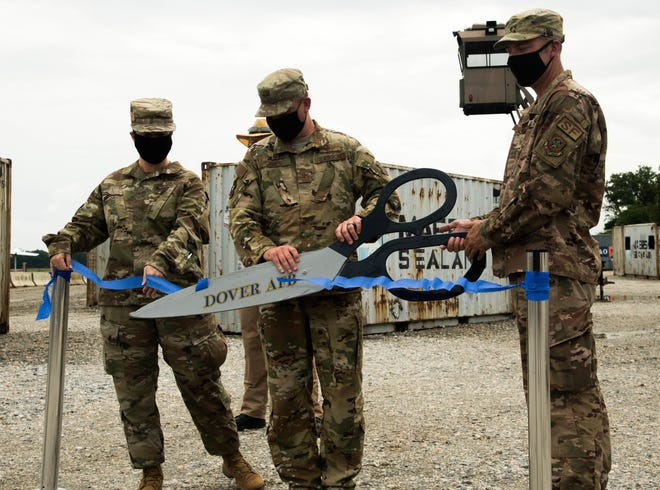 Col. Matthew Jones, 436th Airlift Wing commander and Master Sgt. Kevin Veneman, TALN flight chief, cut a ribbon, marking the opening of the brand-new Tactics and Leadership Nexus July 24 at Dover Air Force Base. This is a first-of-its-kind, permanent, integrated, combat and leadership facility.