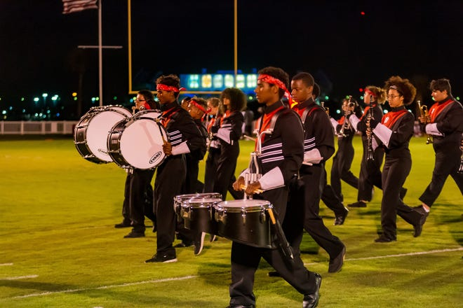 The Terry Parker High School band enters the field for a halftime show during a 2019 football game against Bishop Kenny in Jacksonville.  [Graham Martin/For the Times-Union/File]