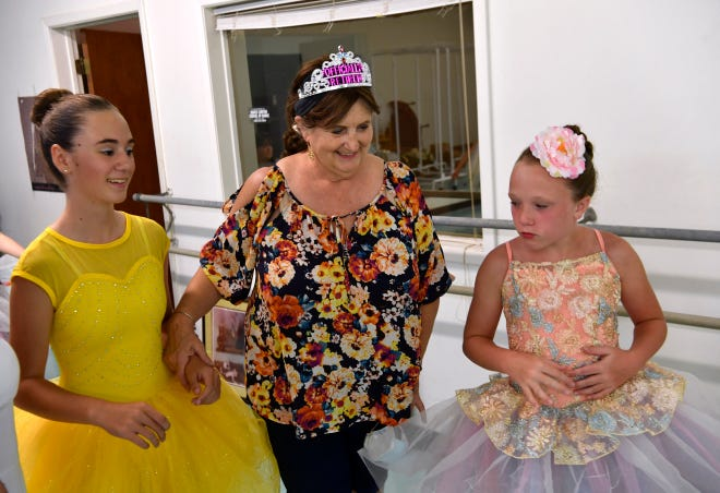Cindy Mundschenk walks with Emma Williams (left) and Ever Fewell on July 24, during a cast party at Dance Ltd. Mundschenk has sold her dance school and is retiring.