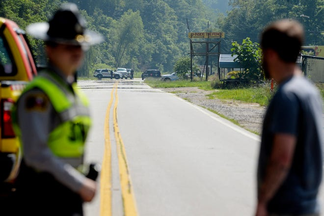 A Haywood County Sheriff's Office deputy was in surgery this morning and a suspect dead after the officer responded to reports of a man firing at traffic from a billboard on U.S. 19/23, according to the Sheriff's Office.