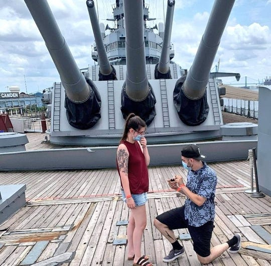 Brandon Walter and Tersa  Large of Massillon, Ohio, get engaged in July while visiting the Battleship New Jersey Museum and Memorial at its South Jersey pier on the Delaware River in Camden, New Jersey