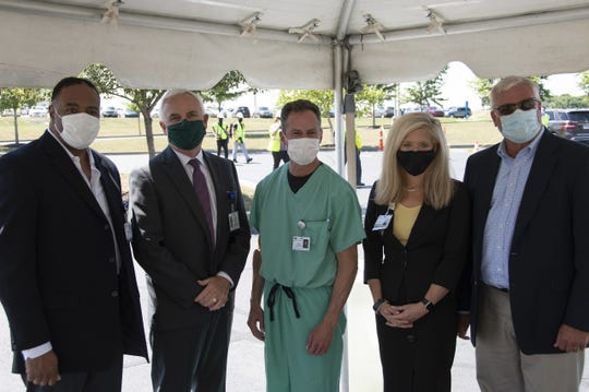 """(L-R) Dr. Jim Flemming, Adena Health System CEO Jeff Graham, Dr. Brian Cohen, Adena Health System COO Kathi Edrington and Operations Vice President at Messer Construction Tim Gusler during the """"topping out"""" ceremony at Adena Regional Medical Center on Wednesday, July 28, 2020."""
