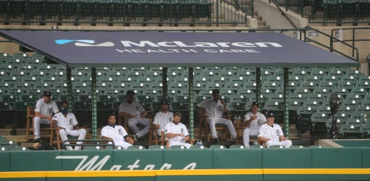 Tigers pitchers sit in the bullpen overflow area during the Tigers' 14-6 loss to the Royals at Comerica Park on Monday, July 27, 2020.