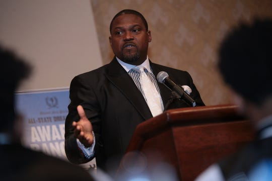 Former Michigan football assistant coach Tyrone Wheatley, the winner of Hal Schram award, speaks to the crowd during the 2015 Detroit Free Press Football Awards Banquet on Sunday, December 13, 2015, in Dearborn.