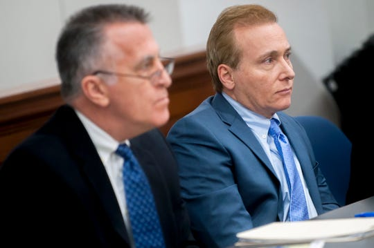 FILE - In this Jan. 28, 2019, file photo, Rene Boucher, right, and his attorney Matt Baker listen to questions during jury selection in a civil trial in Warren Circuit Court in Bowling Green, Ky. Boucher, U.S. Sen. Rand Pau's former neighbor, was resentenced Monday, July 27, 2020, to an extra seven months behind bars and six months in home detention for tackling and injuring the Kentucky lawmaker in anger over lawn care.