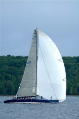 The sun comes out as Windquest crosses the Bell's Beer finish Line in fourth place in their class during the 2010 Pure Michigan Bayview Mackinac Race.