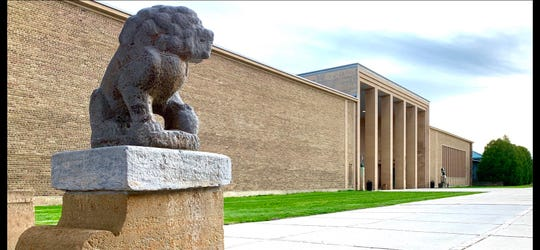 """The statue commonly known as the """"Chinese Dog"""" (it's actually a lion) regards Eliel Saarinen's Cranbrook Art Museum."""