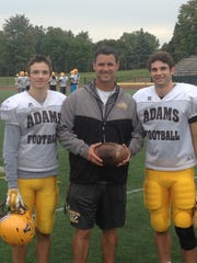 Rochester Adams football coach Tony Patritto with sons Cole (left) and Mark in 2016.
