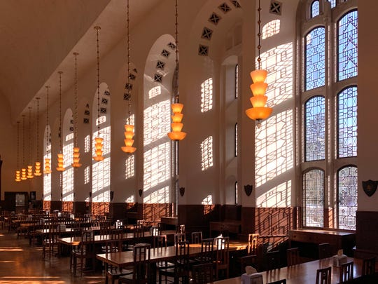 Eliel Saarinen's dining hall on Cranbrook's red-brick campus is a striking sight in the afternoon sun.