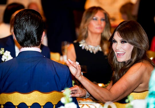 Kimberly Guilfoyle, right, and Donald Trump Jr., the son of President Donald Trump, left, sit with President Donald Trump and first lady Melania Trump during Christmas Eve dinner at Mar-a-lago in Palm Beach, Fla., Tuesday, Dec. 24, 2019.