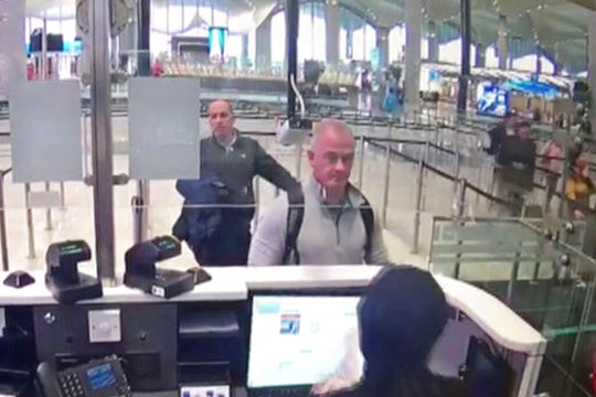 This Dec. 30, 2019 image from security camera video shows Michael L. Taylor, center, and George-Antoine Zayek at passport control at Istanbul Airport in Turkey. Taylor, a former Green Beret and his son, Peter Taylor, 27, were arrested Wednesday, May 20, 2020 in Massachusetts on charges they smuggled Nissan Motor Co. Chairman Carlos Ghosn out of Japan in a box in December 2019, while he awaited trial there on financial misconduct charges.