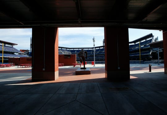An empty Ashburn Alley faces seats at Citizens Bank Park on Monday after the Phillies' game against the Yankees was postponed.
