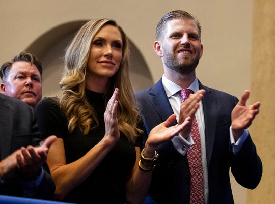 "Eric Trump, the son of President Donald Trump, and Lara Trump listen as President Donald Trump speaks during an ""Evangelicals for Trump Coalition Launch"" at King Jesus International Ministry, Friday, Jan. 3, 2020, in Miami."