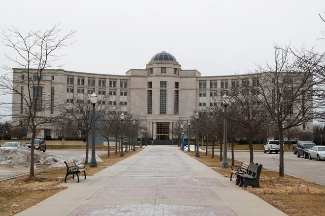 The Michigan Supreme Court's Hall of Justice is seen, Friday, Jan. 17, 2020, in Lansing, Mich.