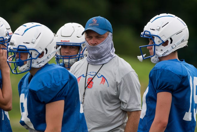South Spencer head coach Jeff Daming runs a drill during practice at South Spencer High school in Rockport, Ind., Monday evening, July 27, 2020.