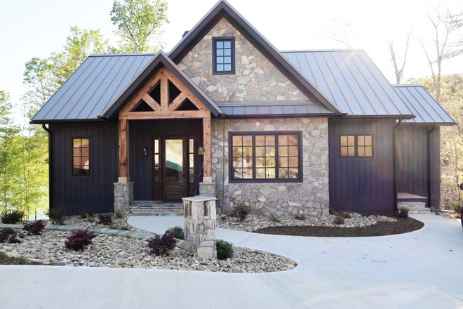 The exterior of the home is finished with stone accents that fit perfectly into the surroundings.
