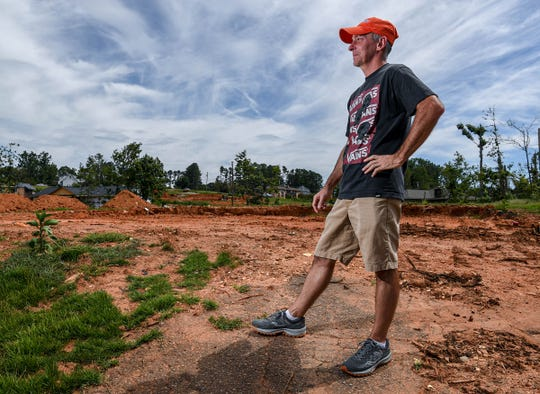 Bill Patterson of Seneca talks about his childhood home being destroyed at the site on Tuesday, July 28, 2020. It was almost four months ago when an EF3 tornado ripped through Seneca the morning after Easter.