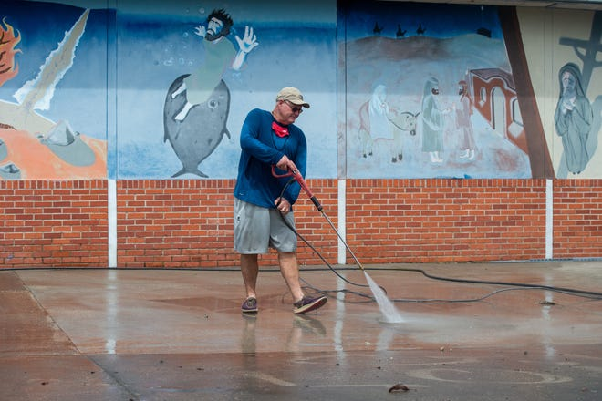 Brian Bonner cleaning student area at Teurlings Catholic in Lafayette. Tuesday, July 28, 2020.