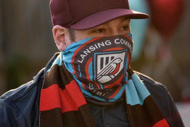 Geoff Sykes, board member, wears a Lansing Common Football Club mask during a launch party at Ozone's Brewhouse on Monday, July 27, 2020, in Lansing.