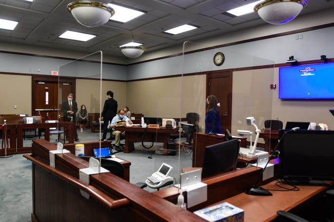 Plexiglass barriers have been set up in Ingham County Judge Rosemarie Aquilina's courtoom, Tuesday, July 28, 2020, prior to the county's first jury trial since the pandemic began.
