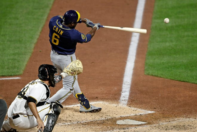 Milwaukee Brewers' Lorenzo Cain drives in a run with a single off Pittsburgh Pirates relief pitcher Nik Turley in the seventh inning.