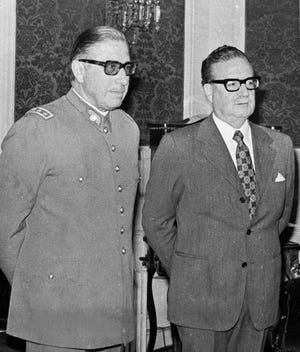 Chilean Gen. Augusto Pinochet, left, and President Salvador Allende attend a ceremony naming Pinochet as commander in chief of the Army in this Aug. 23, 1973, file photo. Eighteen days later, Pinochet took power in a coup in which Allende died.