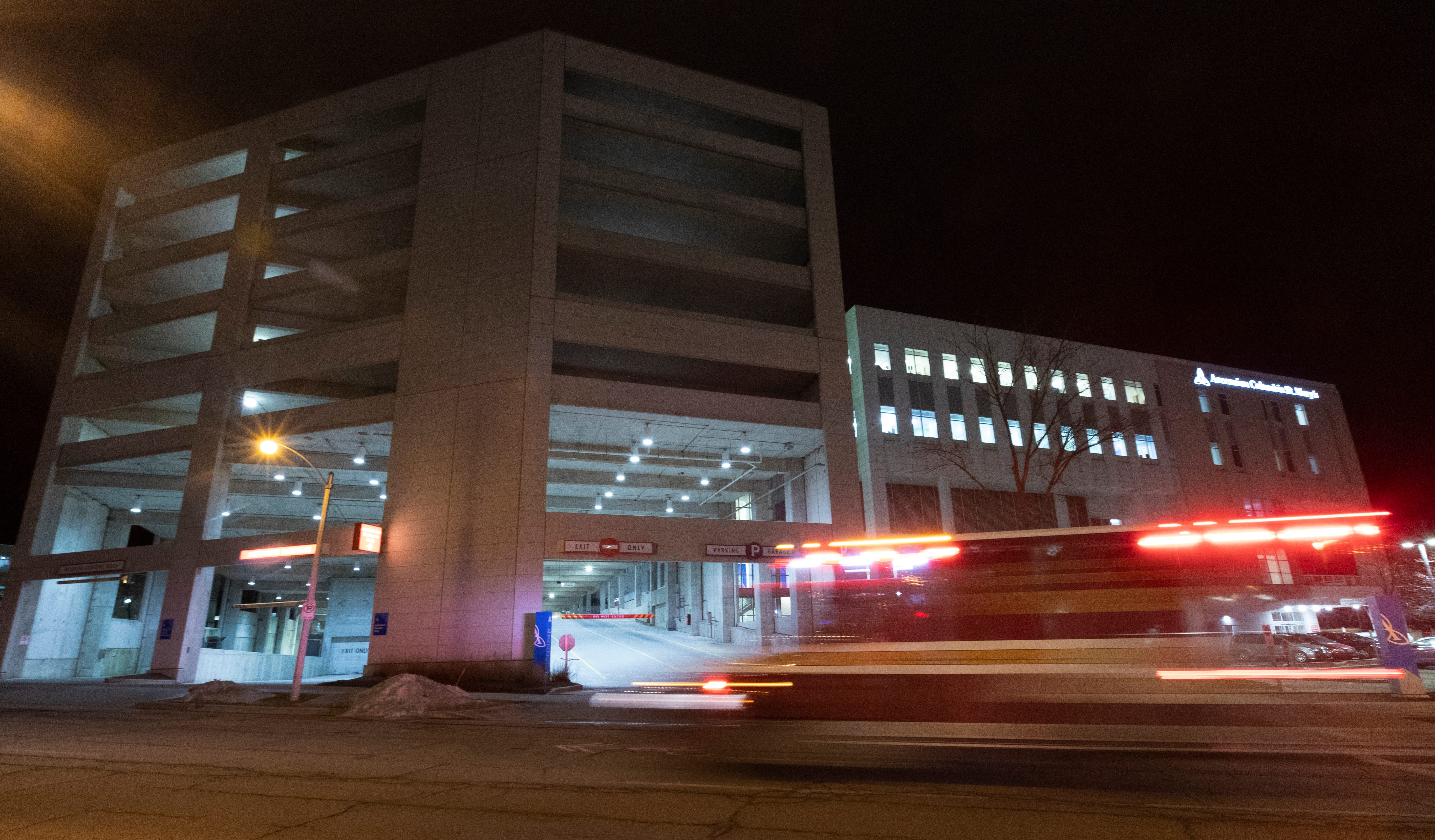 An ambulance passes the entrance to a parking ramp at Ascension Columbia St. Mary's Hospital Milwaukee Tuesday, February 25, 2020 in Milwaukee, Wis. The Milwaukee Journal Sentinel enlisted the aid of an architectural security consultant to evaluate parking ramps at five Milwaukee hospitals.