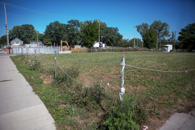 A grass lot across from the riverfront canal was recently bought by the Delaware Advancement Corporation for $100,000 in partnership with the City of Muncie.