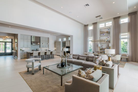 London Bay Homes' contemporary Martinique model offers lake views in 3,615 square feet of living space within Mediterra's Lucarno neighborhood.