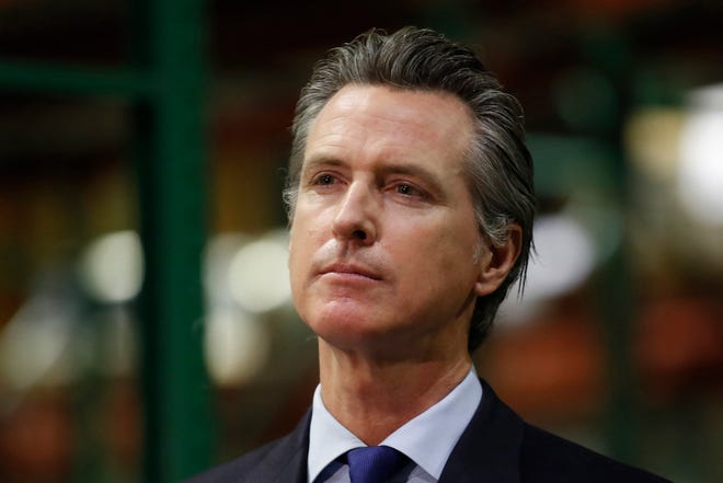In this file photo, Gov. Gavin Newsom listens to a reporter's question during a news conference in Rancho Cordova, Calif., Friday, June 26, 2020.